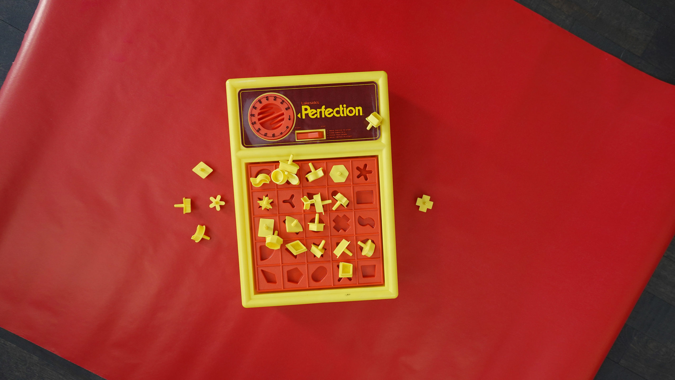 A game of perfection on red wrapping paper