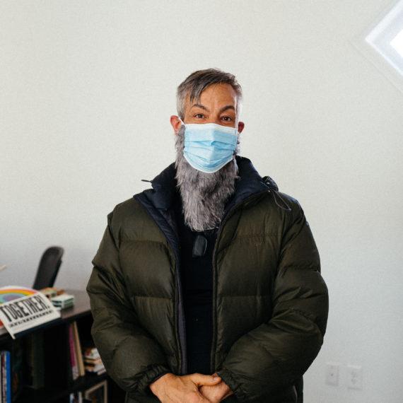 Man with medical mask and fake beard