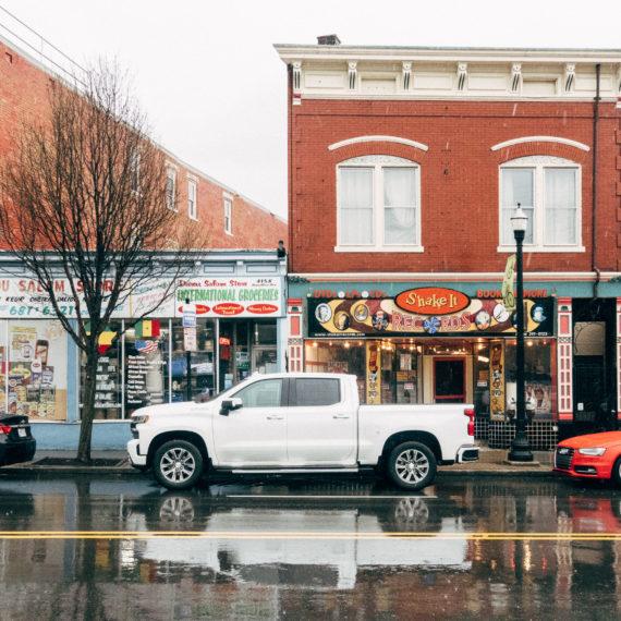 A neighborhood record store in the rain