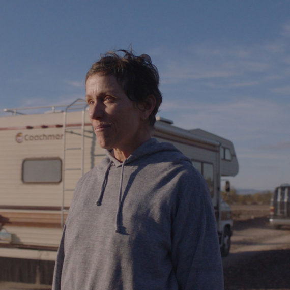 Frances McDormand in front of RVs