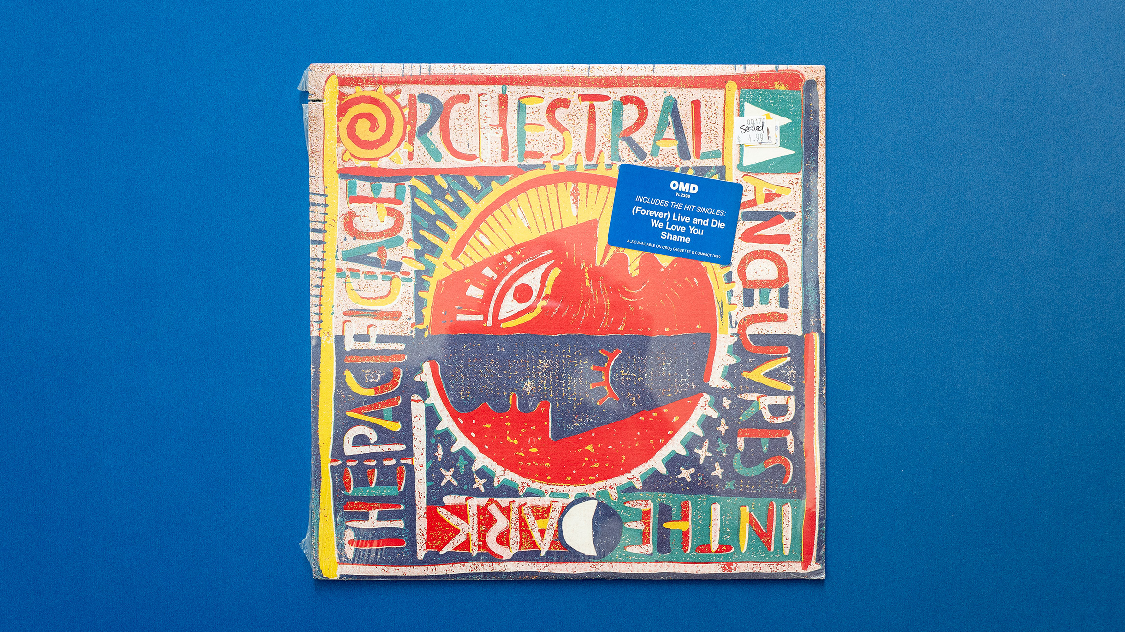 A colorful record cover for the band Orchestral Manoeuvers in the Dark