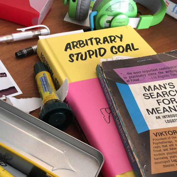 books and markers strewn across a desk