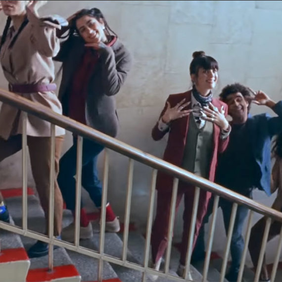 People on stairs choreographed for a music video