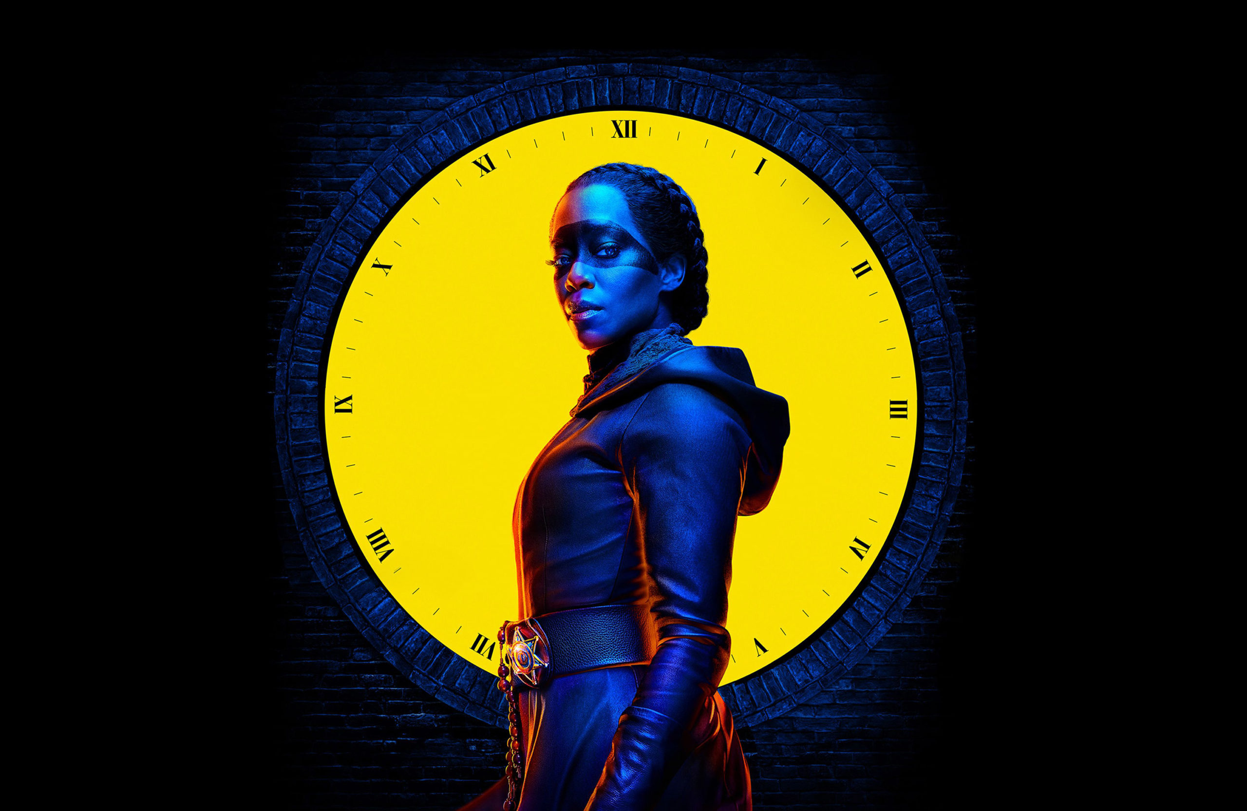 Regina King as Sister Night in front of a yellow clock
