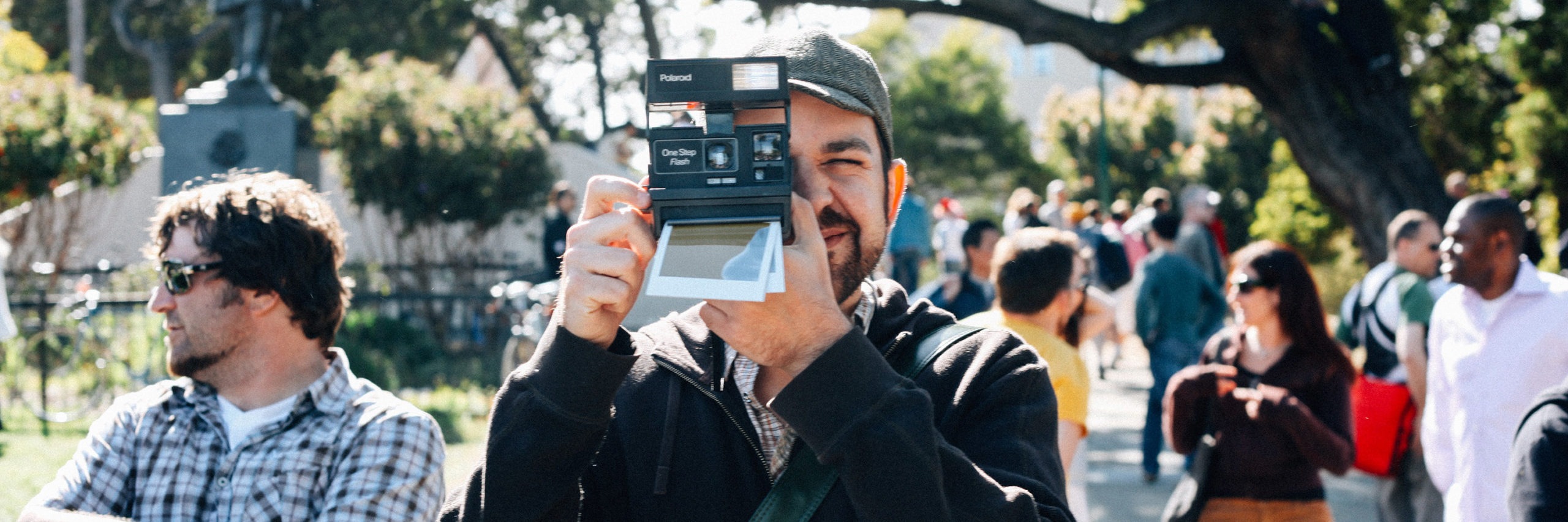 Man with a Polaroid camera