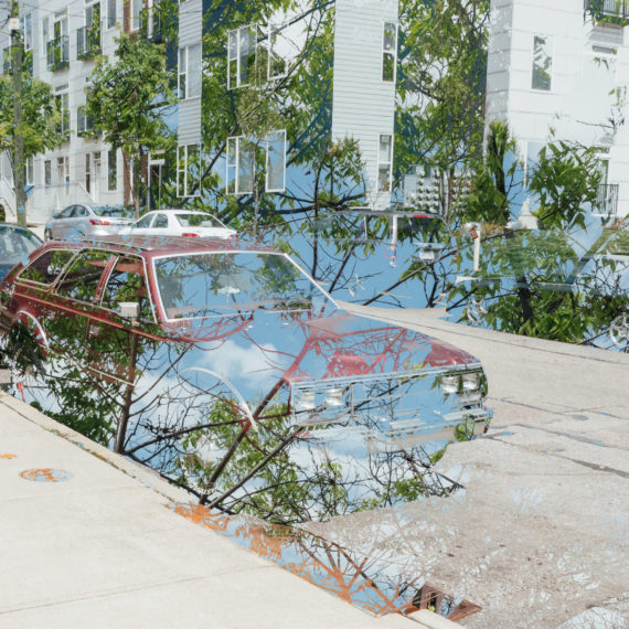 Double exposure of a car and a tree
