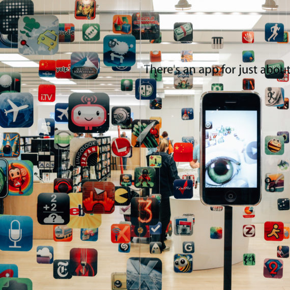 Apple Store with images of app icons hanging in the window