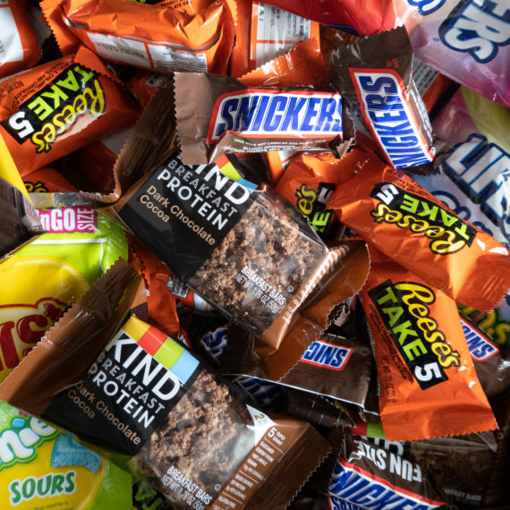 A drawer full of candy bars, mostly chocolate