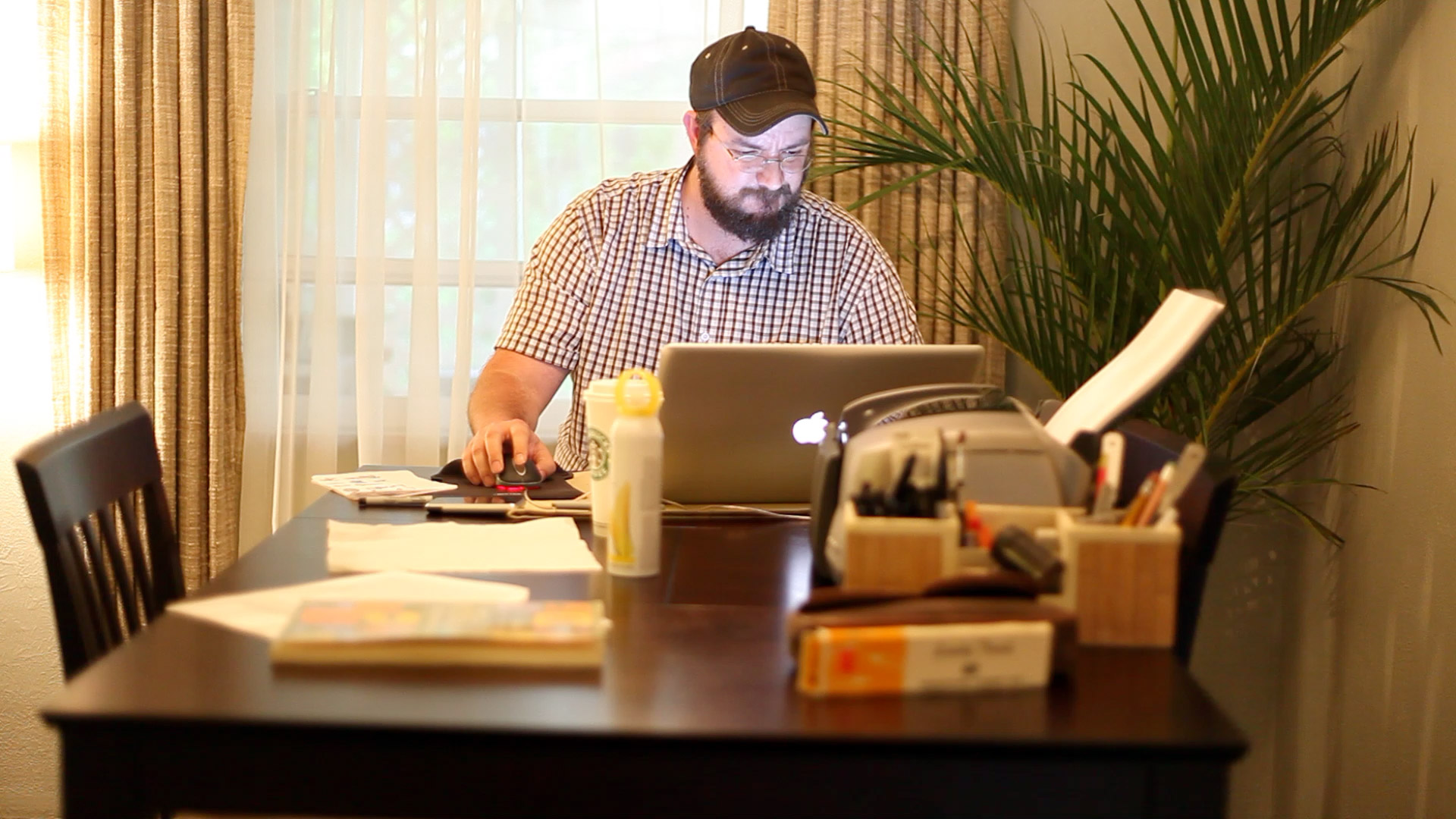 A man works on a laptop