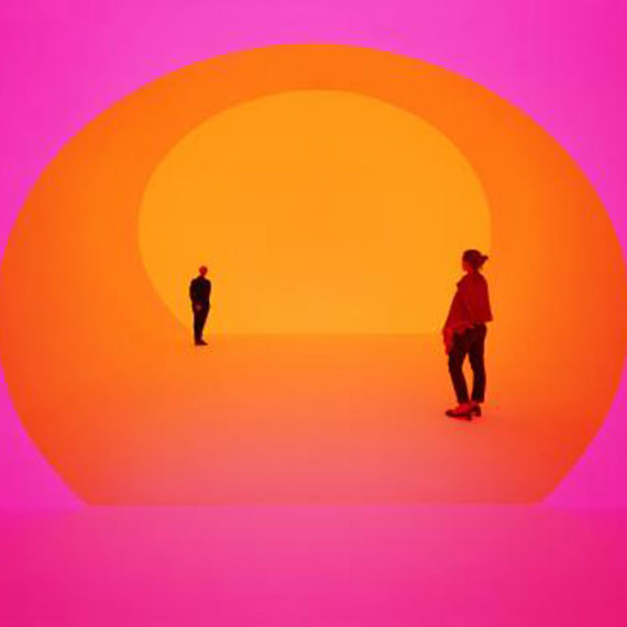 Figures stand washed in orange and pink light