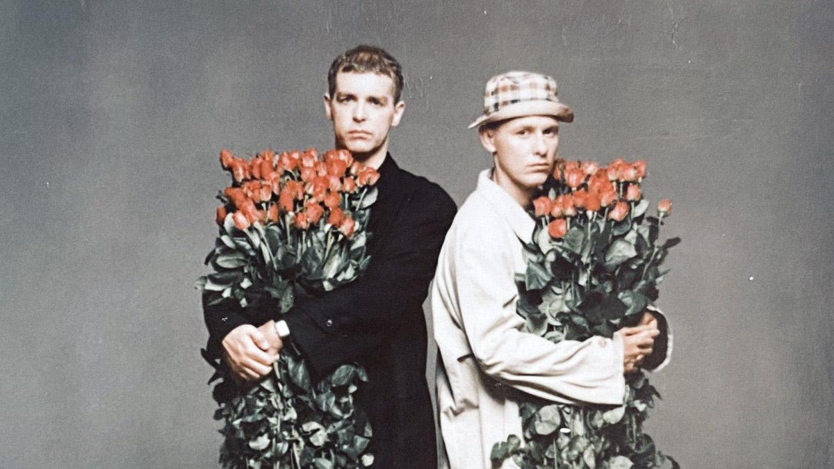 Two men holding roses