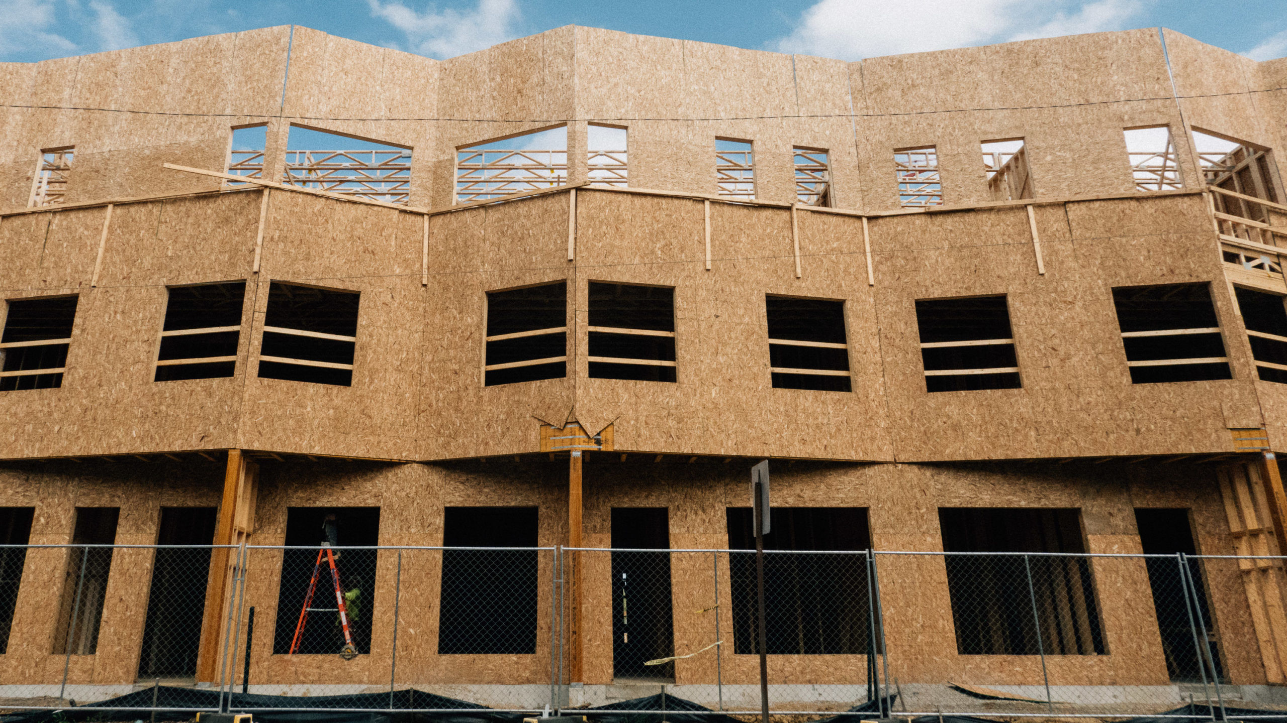 A building made of plywood under construction