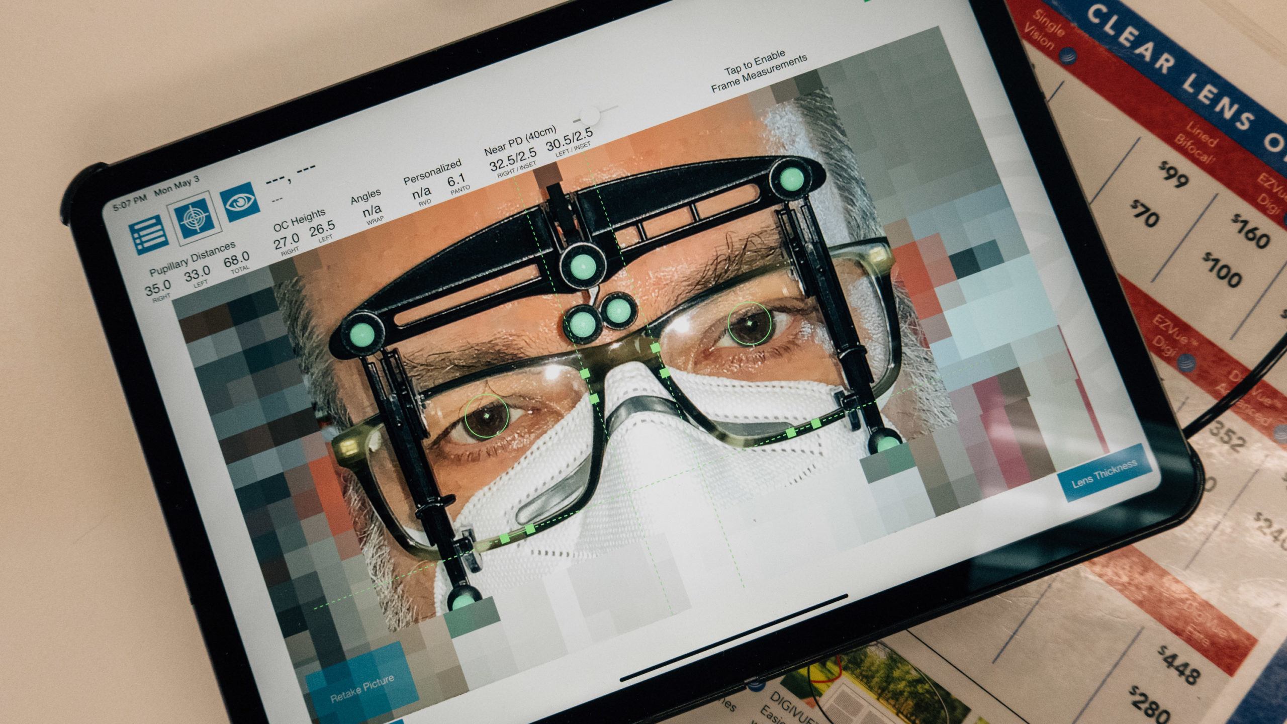 A tablet with an app determining pupillary distance for eyeglasses