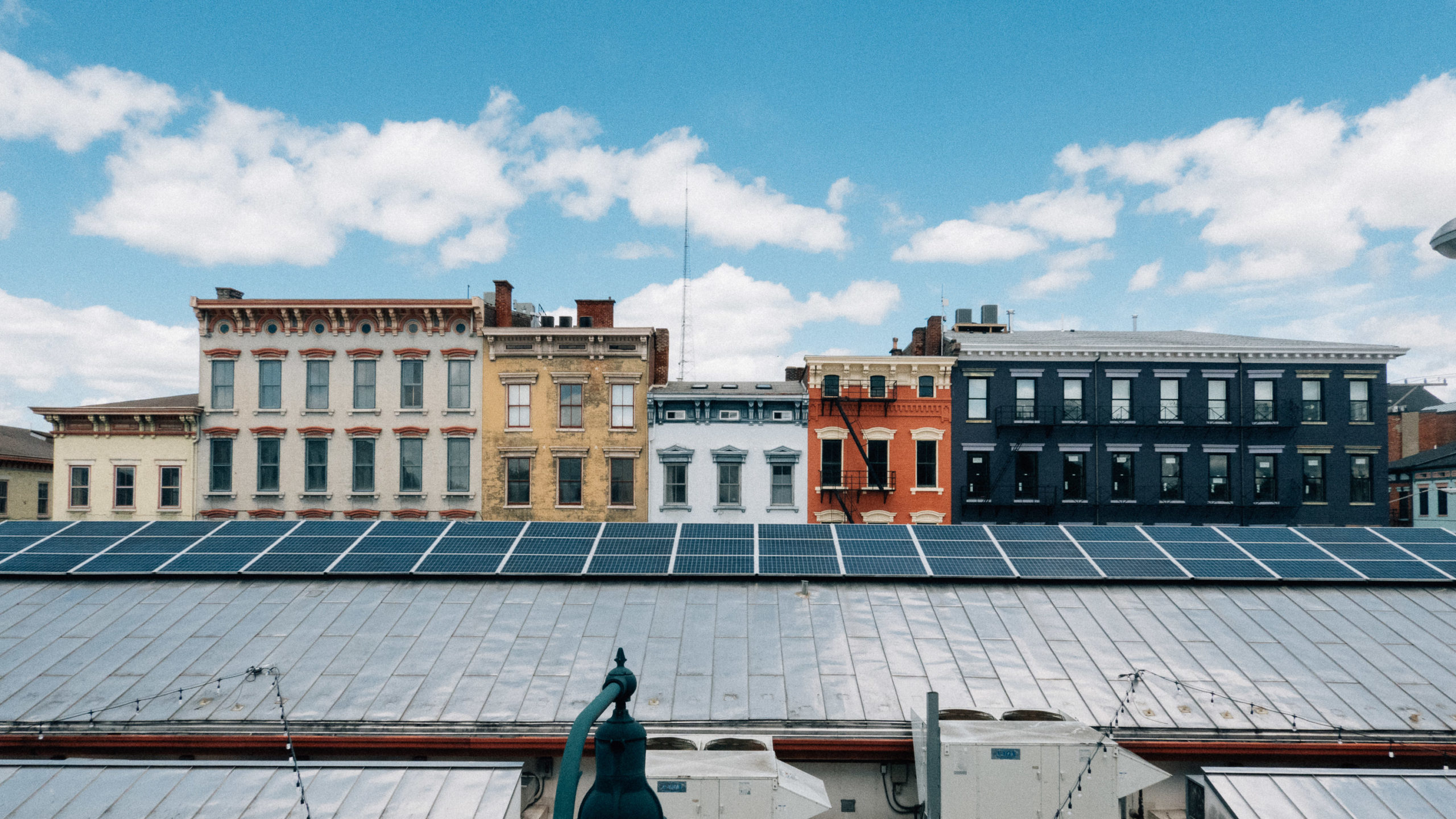 A view of city buildings and a solar roof