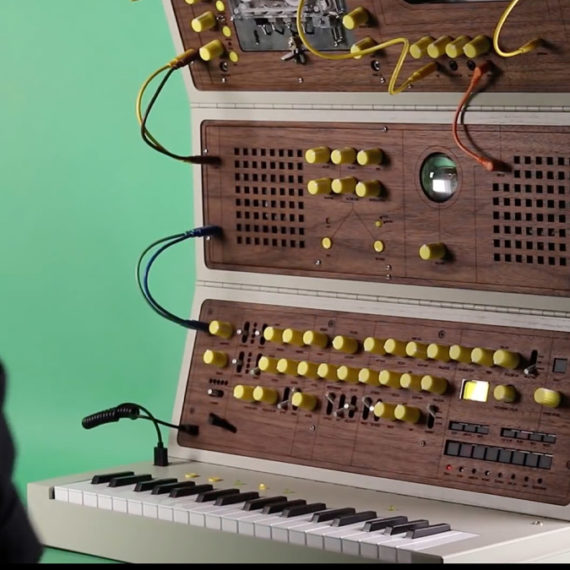 A synthesizer with wood paneling