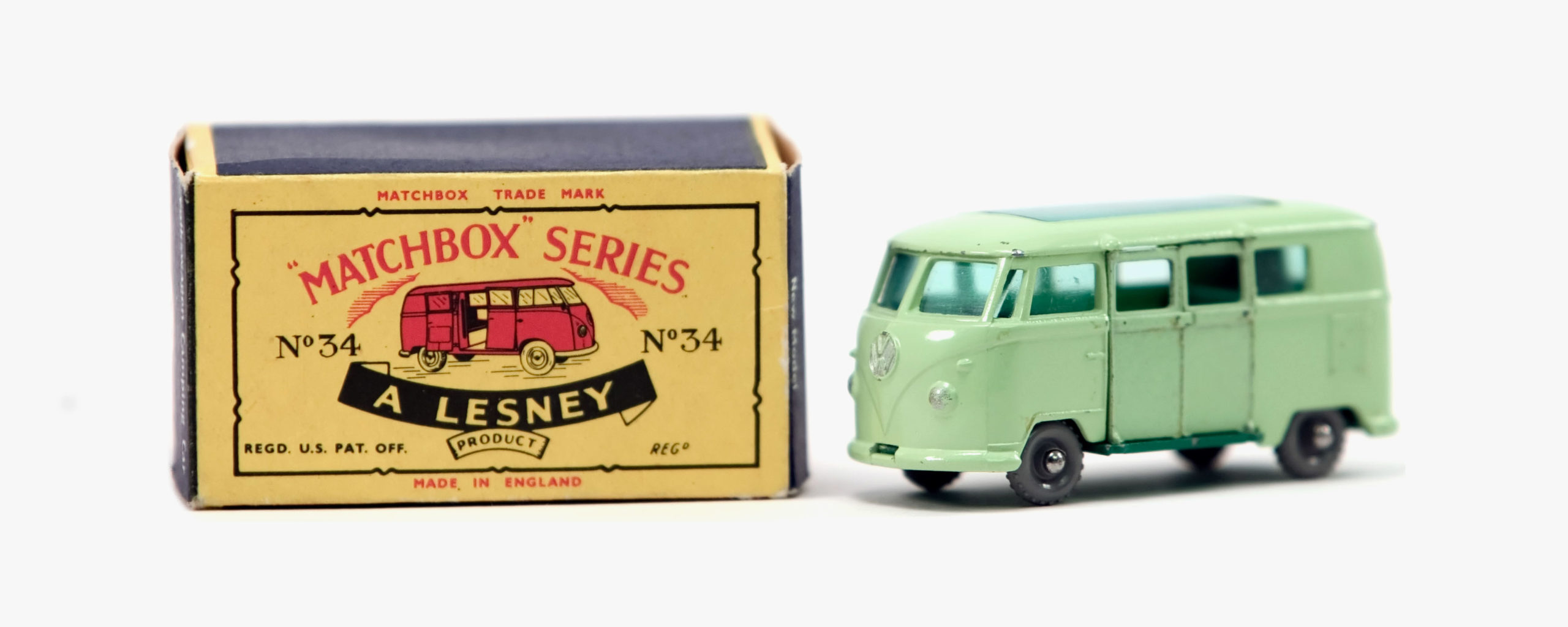 An antique Matchbox Series box with green VW bus toy
