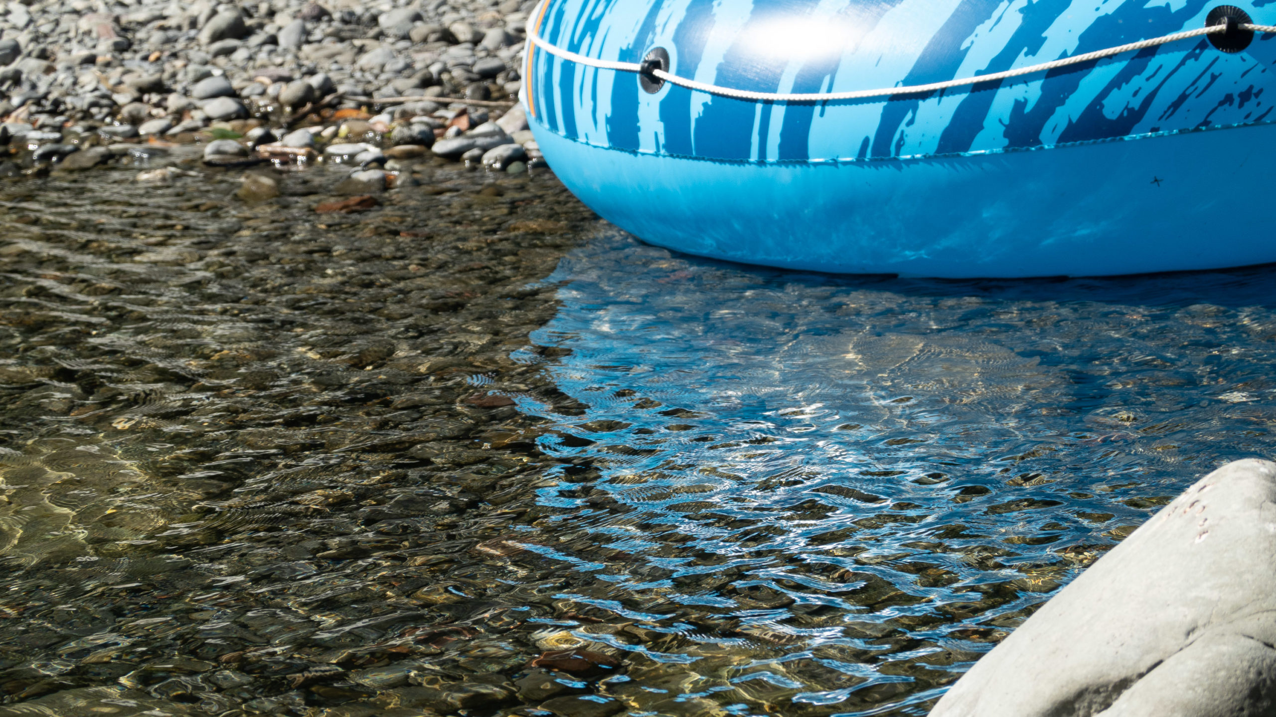 an inflatable inner tube on rippling creek waves