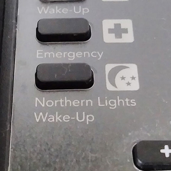 A hotel phone with a Northern Lights button