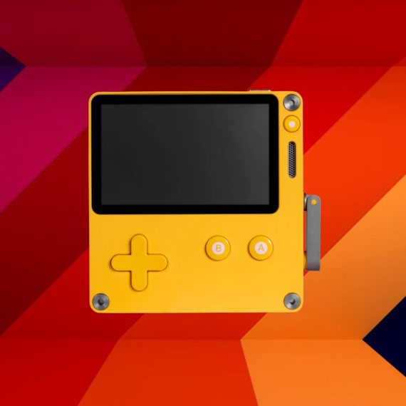 A yellow handheld videogame system