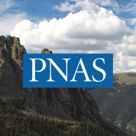 PNAS logo over mountains