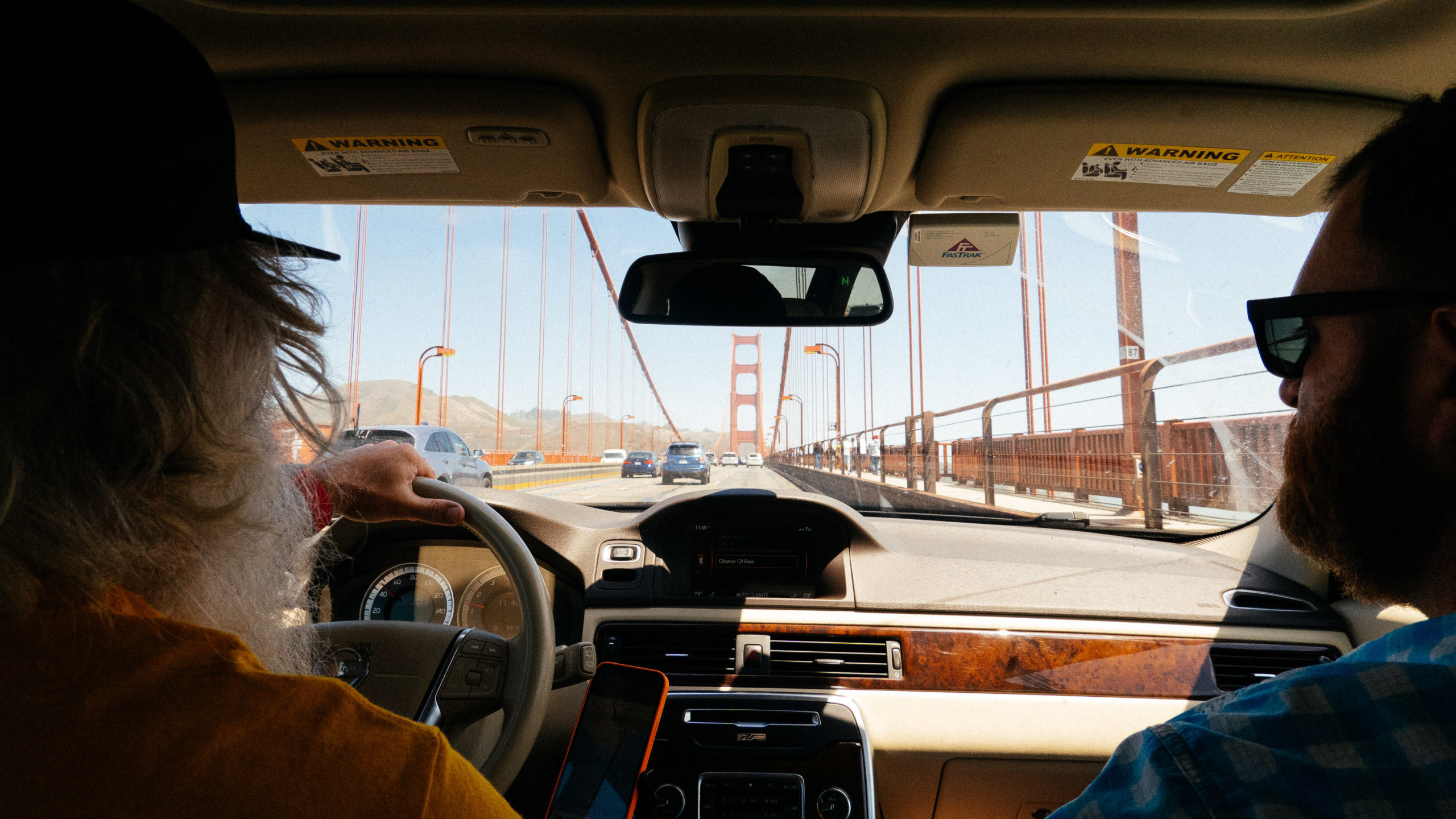 Looking through the windshield of a car driving across the Golden Gate bridge