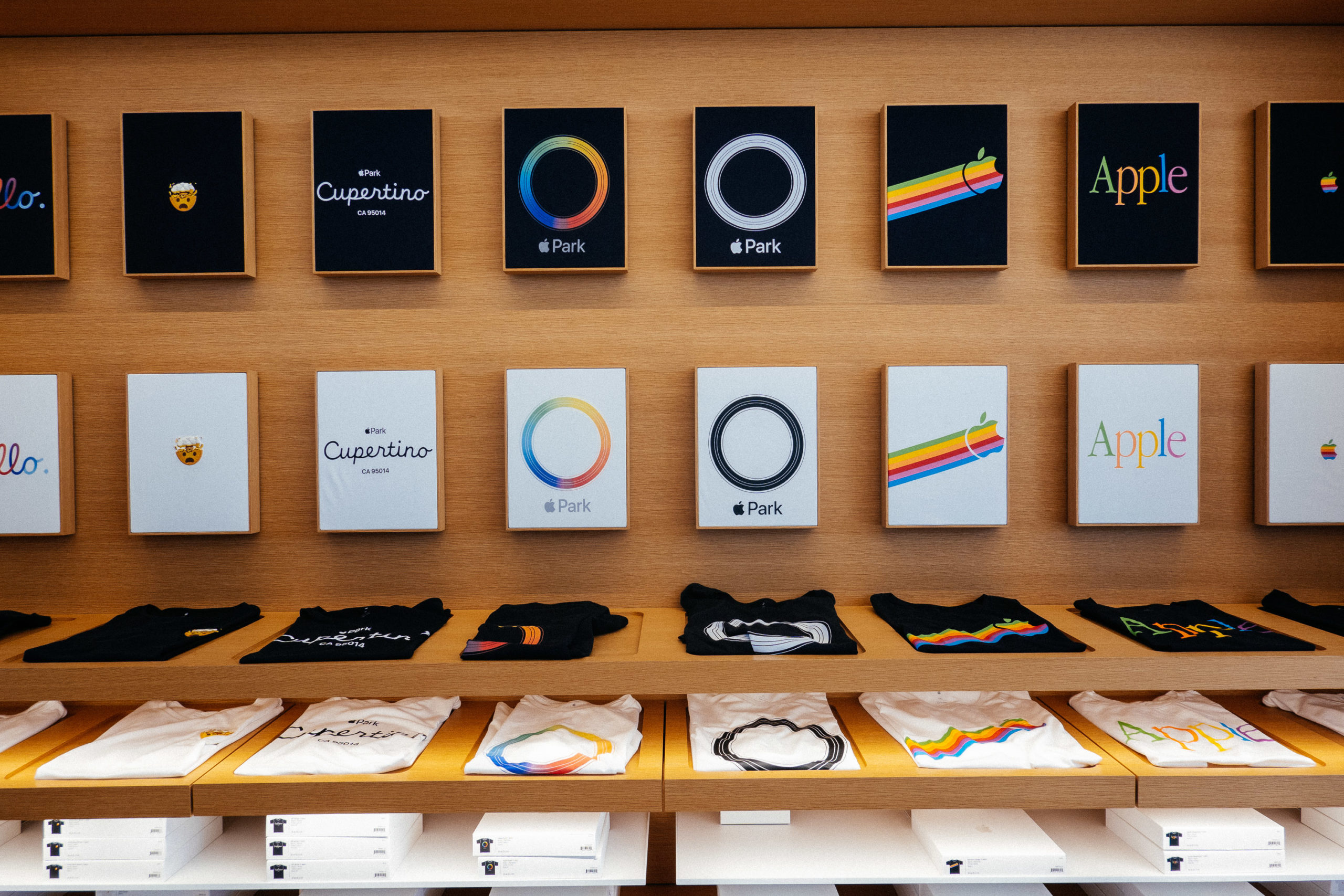 T-shirts with Apple branding displayed in a retail setting
