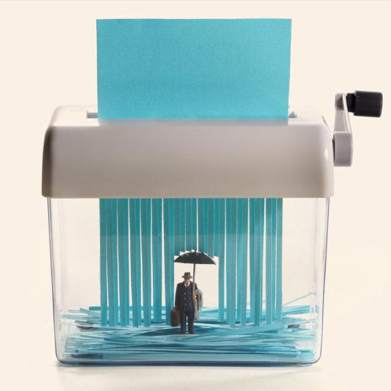 A paper shredder represents falling rain in a miniature diorama