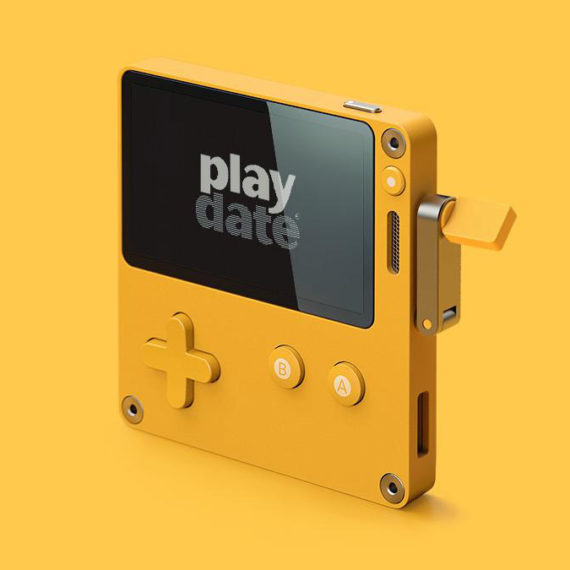 A yellow handheld videogame console with a crank