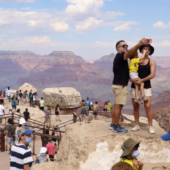 A large group of tourists at the Grand Canyon