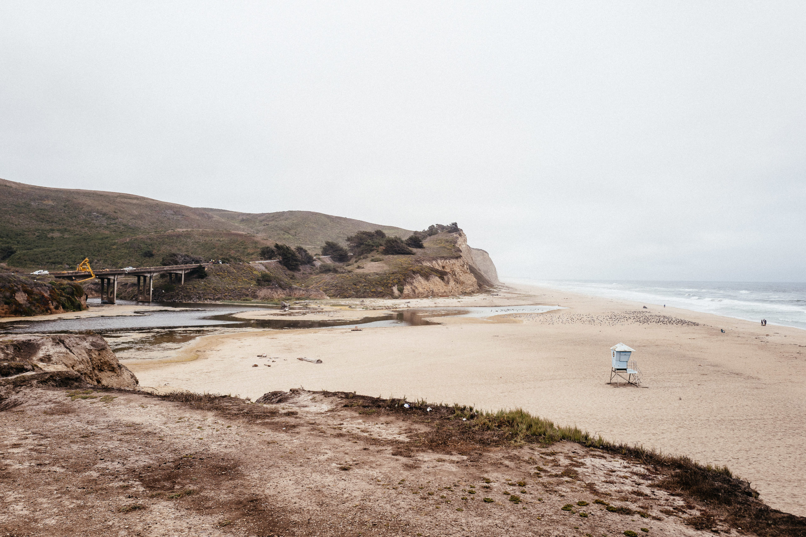 A largely empty beach on an overcast day
