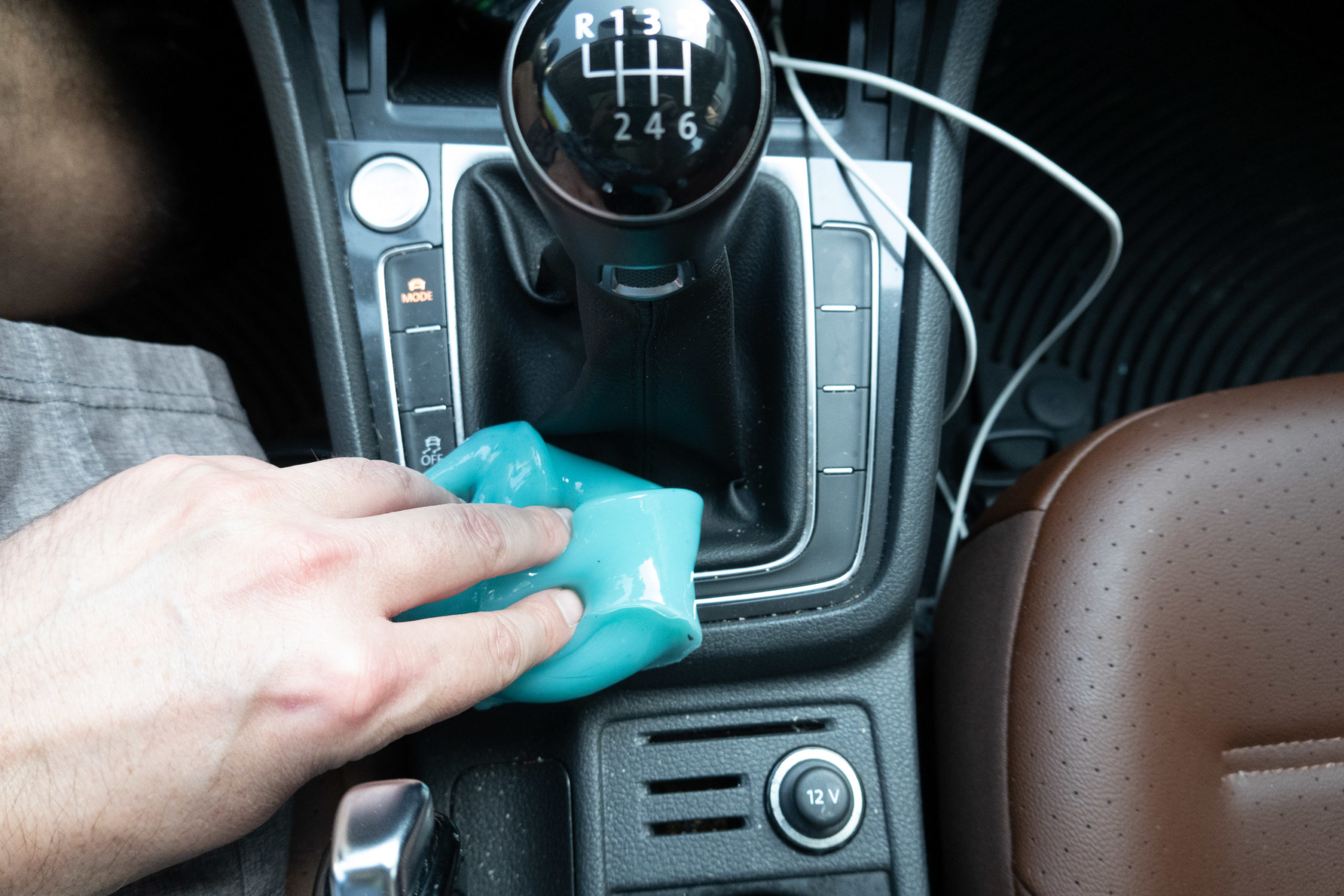 Cleaning a car with teal goop