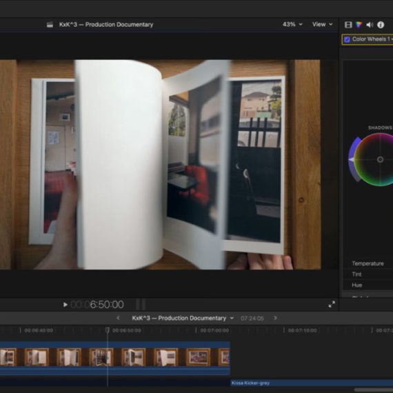 A screenshot of a video editing application with video of a hand flipping through the pages of a book filled with photographs taken in Japan